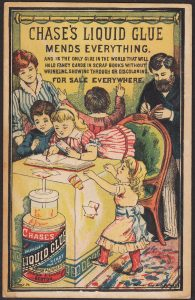 Chase's Liquid Glue Victorian Trade Card, family with scrapbook project at table.